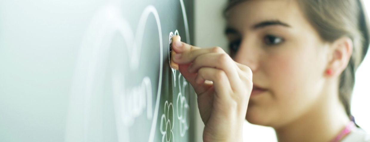 Girl at Chalkboard - Impact of ACEs on Education