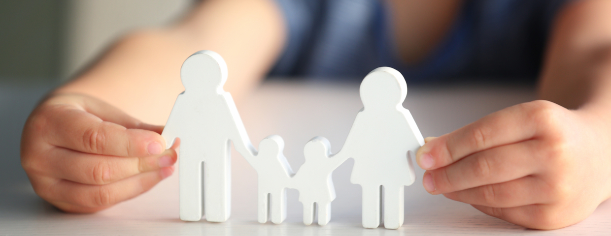 child holding figure in shape of family