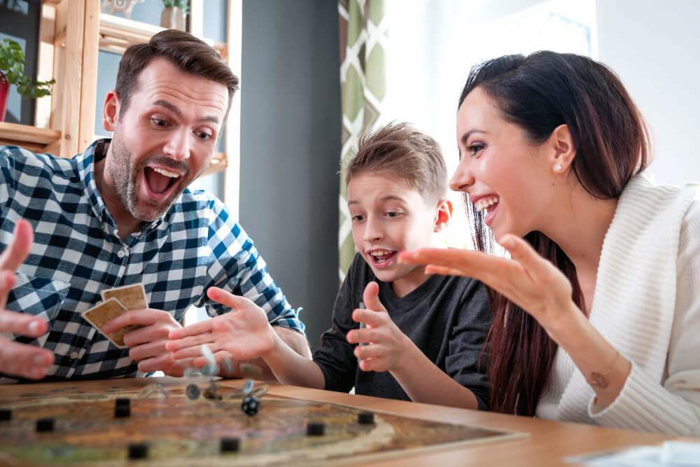 family enjoying game night together