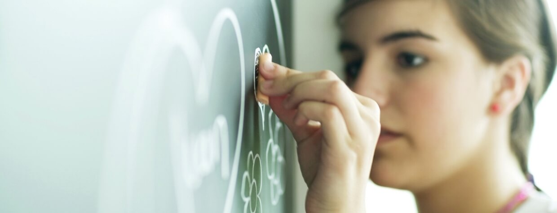 Child drawing on chalkboard-1