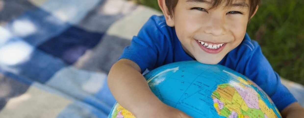 Close-up portrait of a cute young boy holding globe at the park-433929-edited