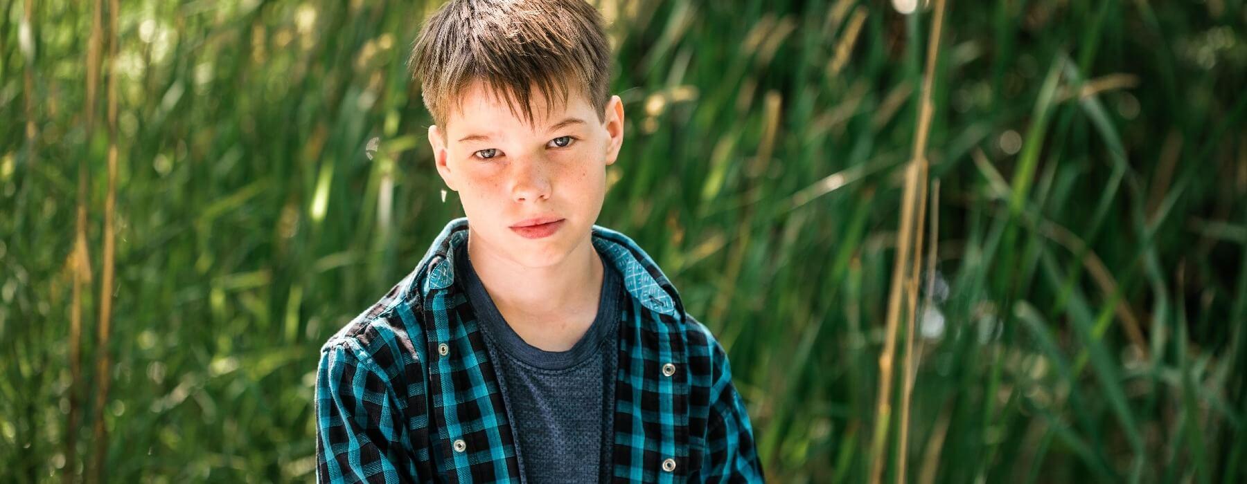 Boy standing in field