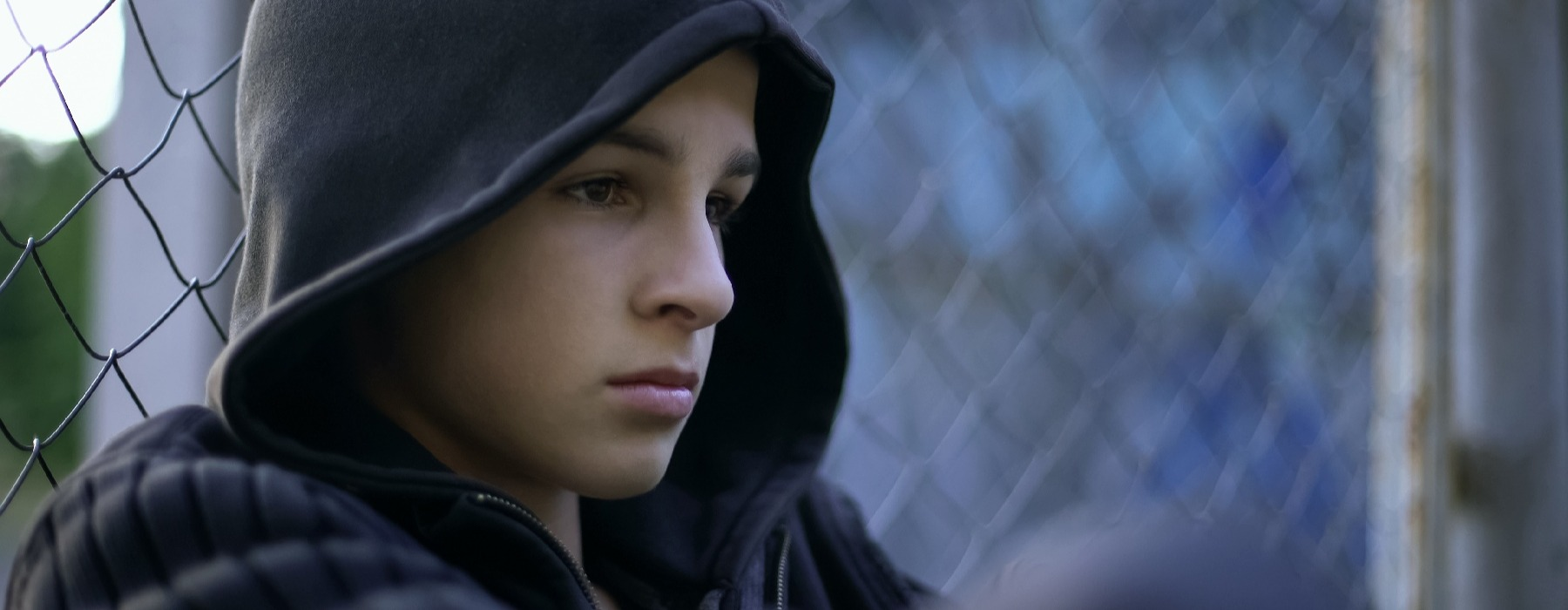 sad teen boy against the wall-4-1
