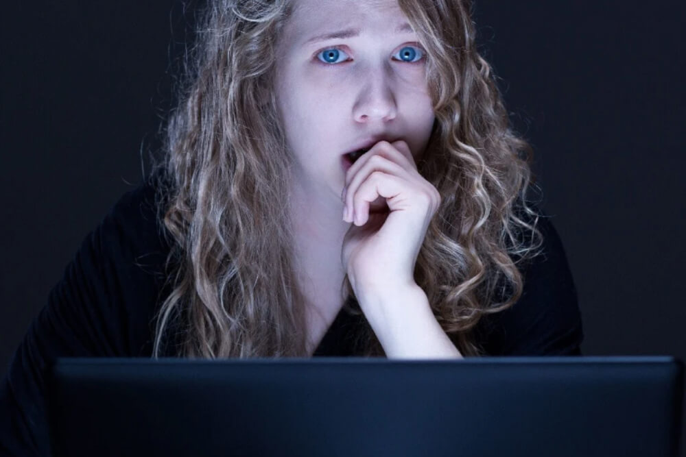 teen on laptop, scared or upset, cyber and online safety